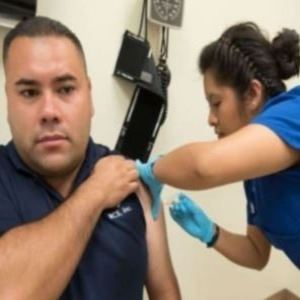 Nurse giving a man a flu shot